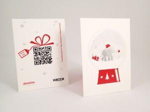 Weihnachtskarte mit silberner und roter Heißfolienprägung